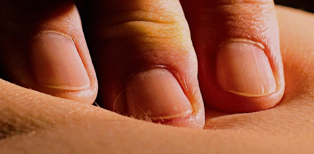 Fingerfriktionen am Kreuzbein